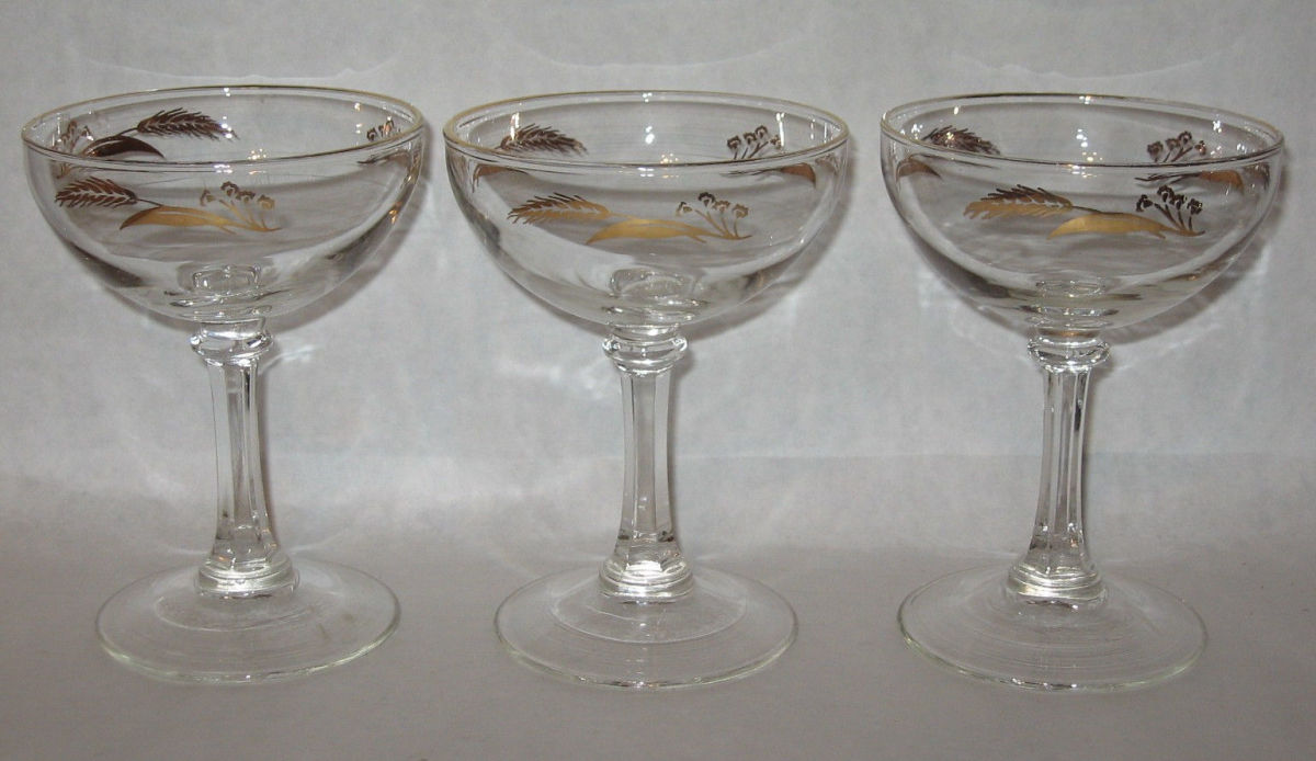 "Here are three Lifetime ""PRAIRIE GOLD"" sherbet or champagne stemware  they are six ounce  glasses and are five inches tall "" made by Homer Laughlin with 24k gold accents in the PRAIRIE GOLD design."