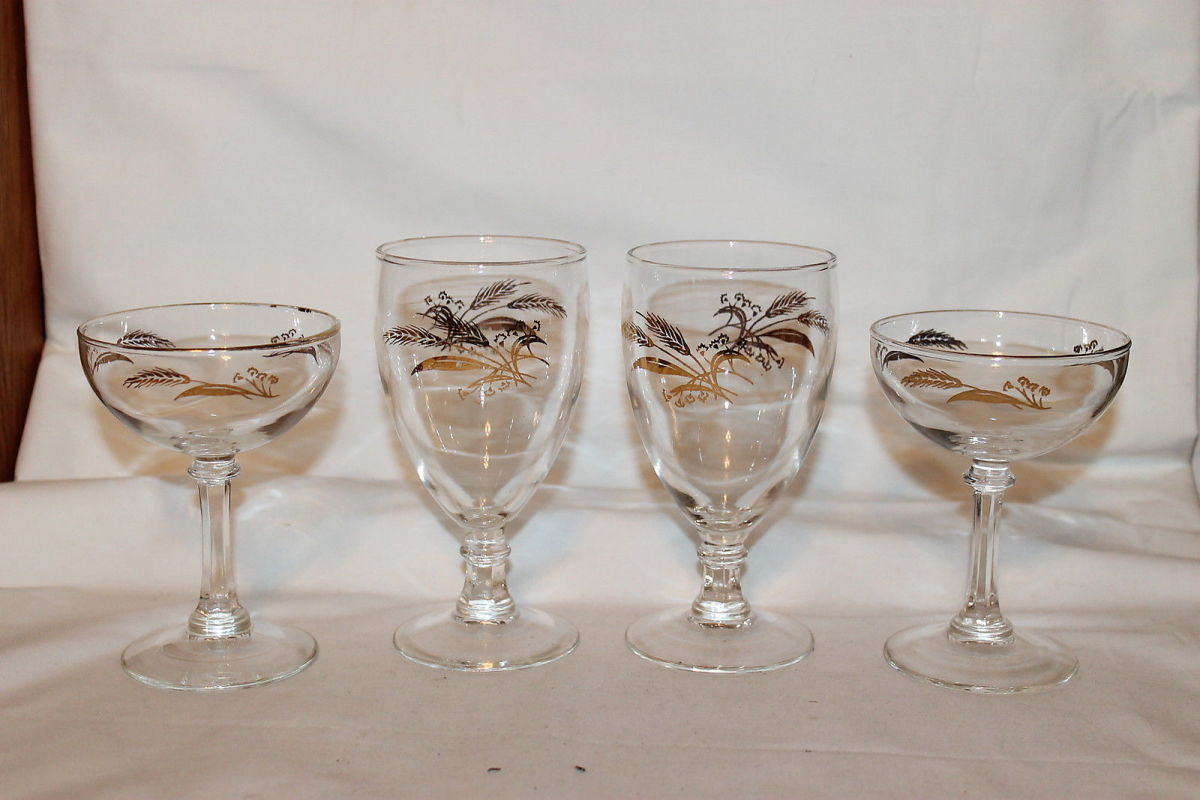 "In the photo above are four vintage stemware's in the Prairie Gold design. The tall waters goblets are 5 3/4"" tall and 2 7/8"" wide. The champagnes are 4 3/4"" x 3 1/2""."