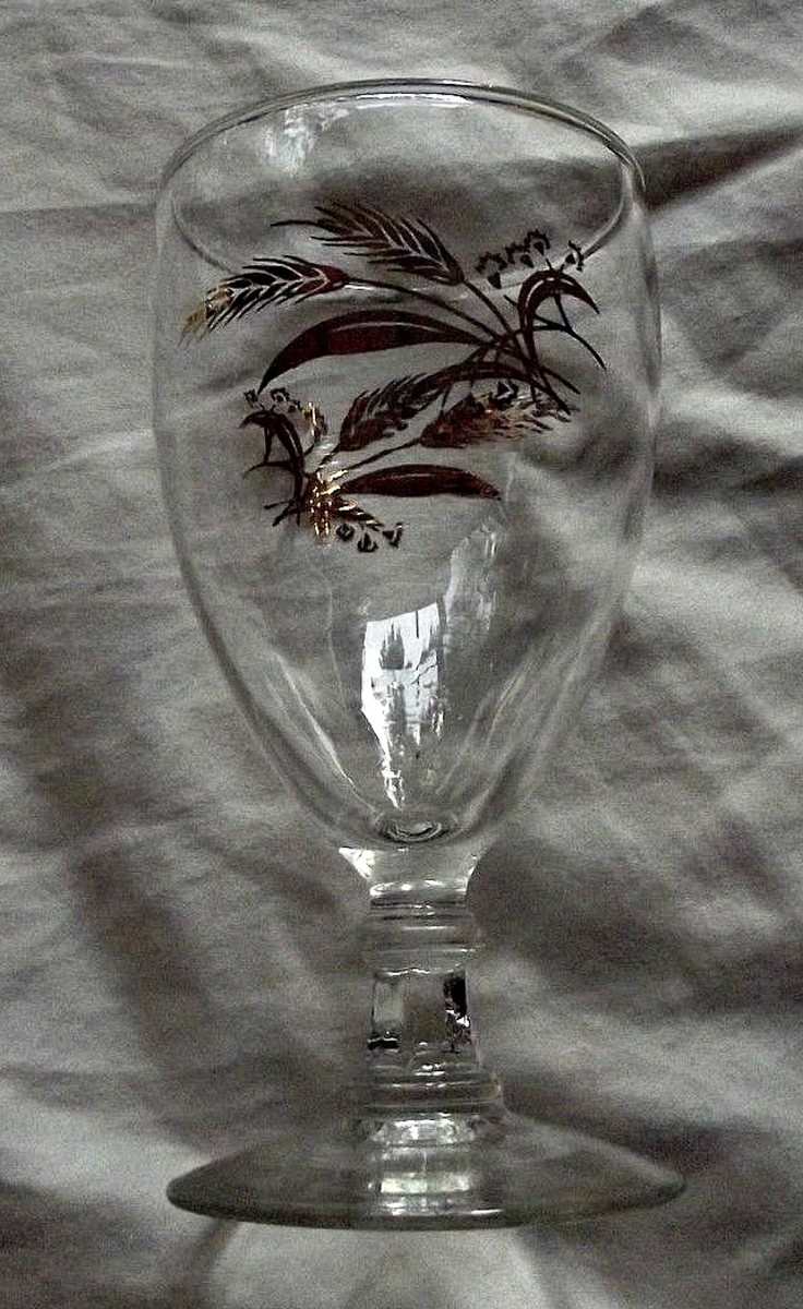 """The water goblet, 5-7/8"""" tall in the Prairie Wheat Lifetime gold Golden accent crystal glasses stemware made by Homer Laughlin"""