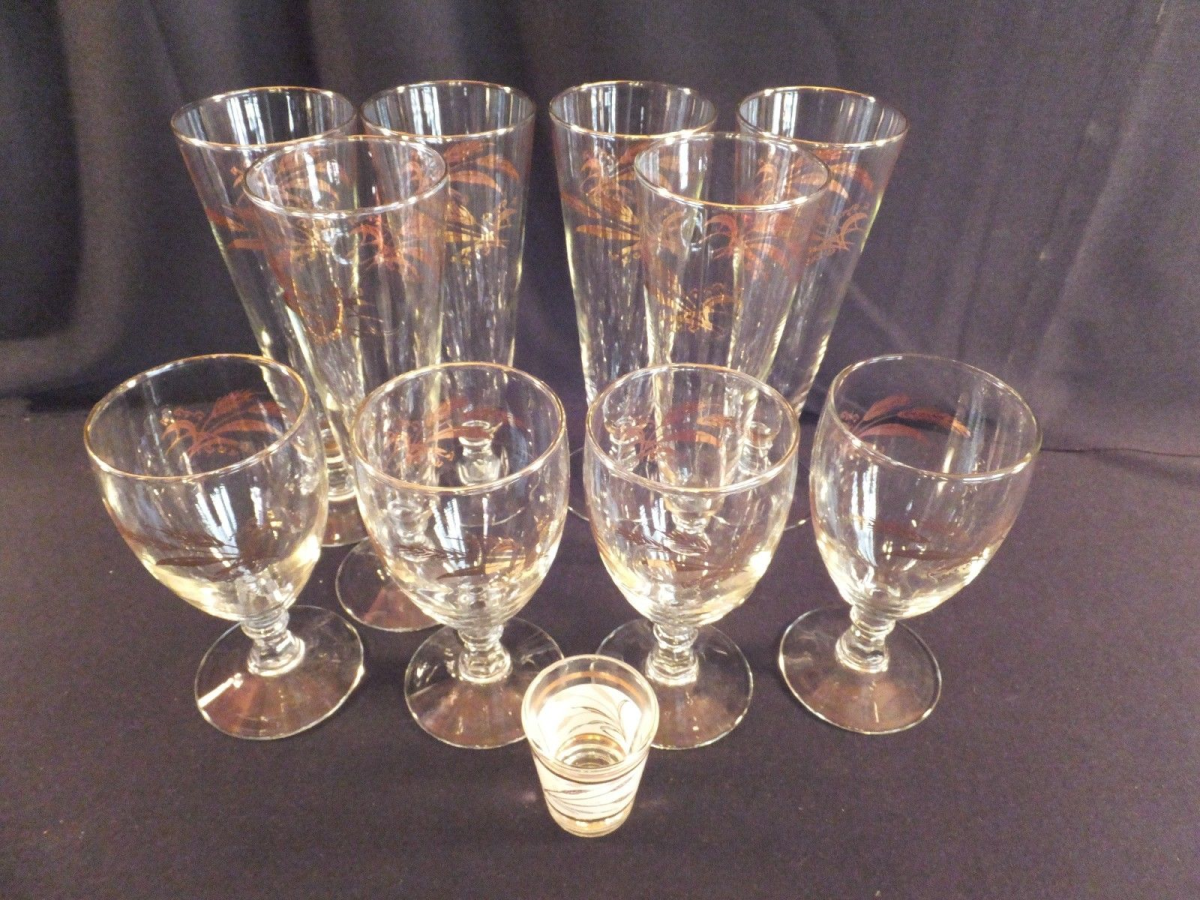 """The Pilsner is 8.25"""" tall, the water glass is 5.75"""" tall and the shot glass is 2.25"""" tall"""