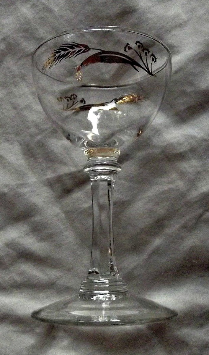 """The sherbet cups, 4-7/8"""" tall by 3.75"""" ...  in the Prairie Wheat Lifetime gold Golden accent crystal glasses stemware made by Homer Laughlin"""