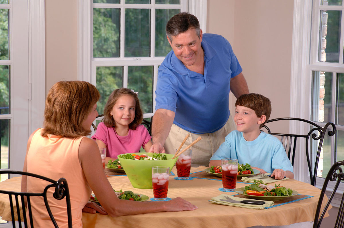 Family together at mealtime