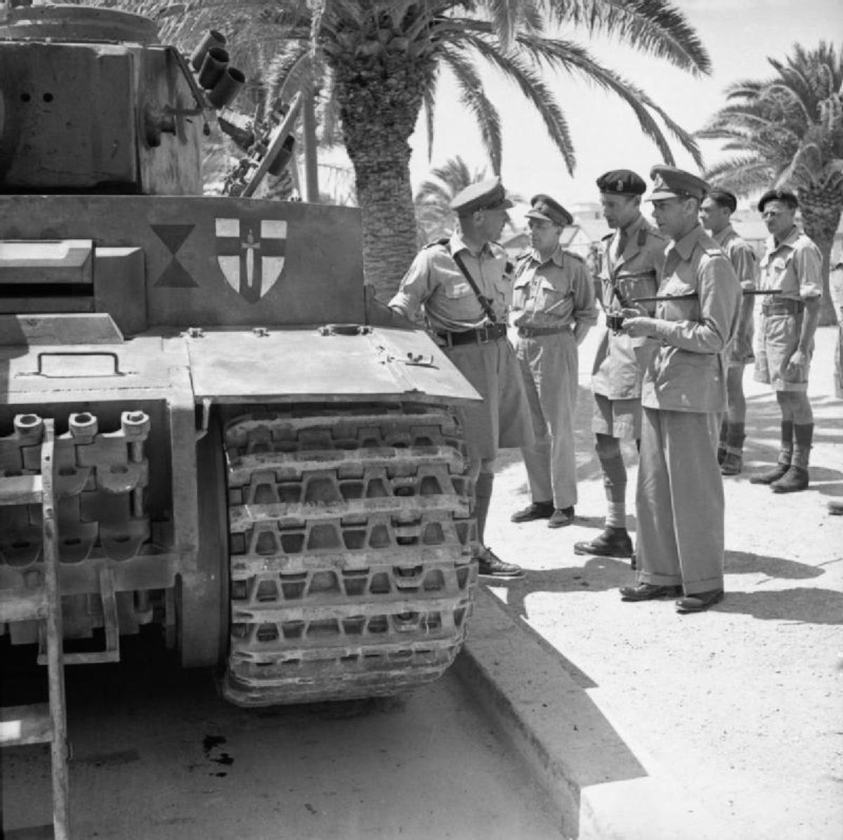 Photo by Sgt Gunn, shows The British Army in Tunisia, 1943. Here, King George VI inspected the captured Tiger Tank 131.