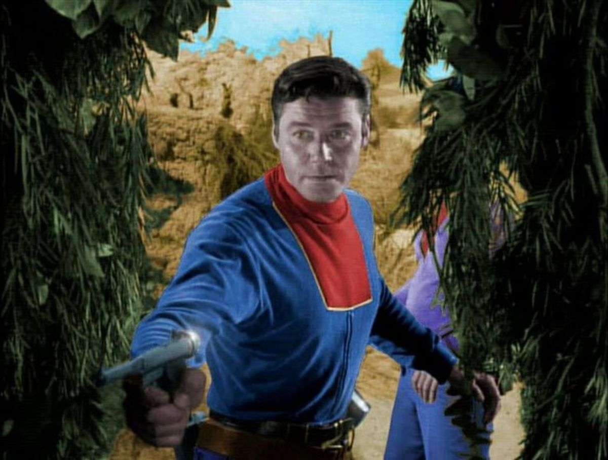 Guy Williams as Professor John Robinson doing what he does best. Defending the family from monsters and aliens