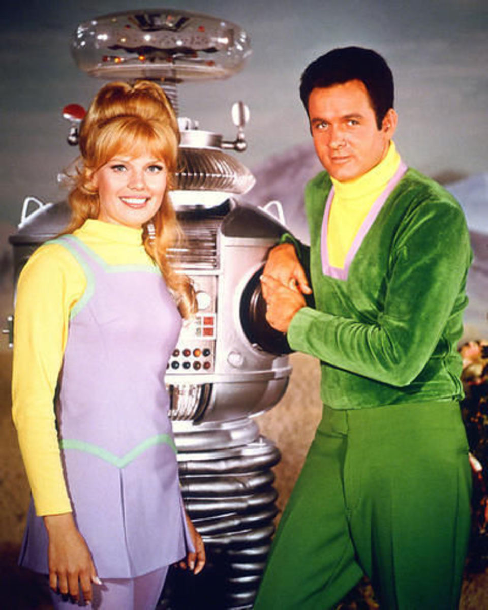 Judy Robinson played by Marta Kristen. the Robot played by Bob May and Major Don West  played by Mark Goddard