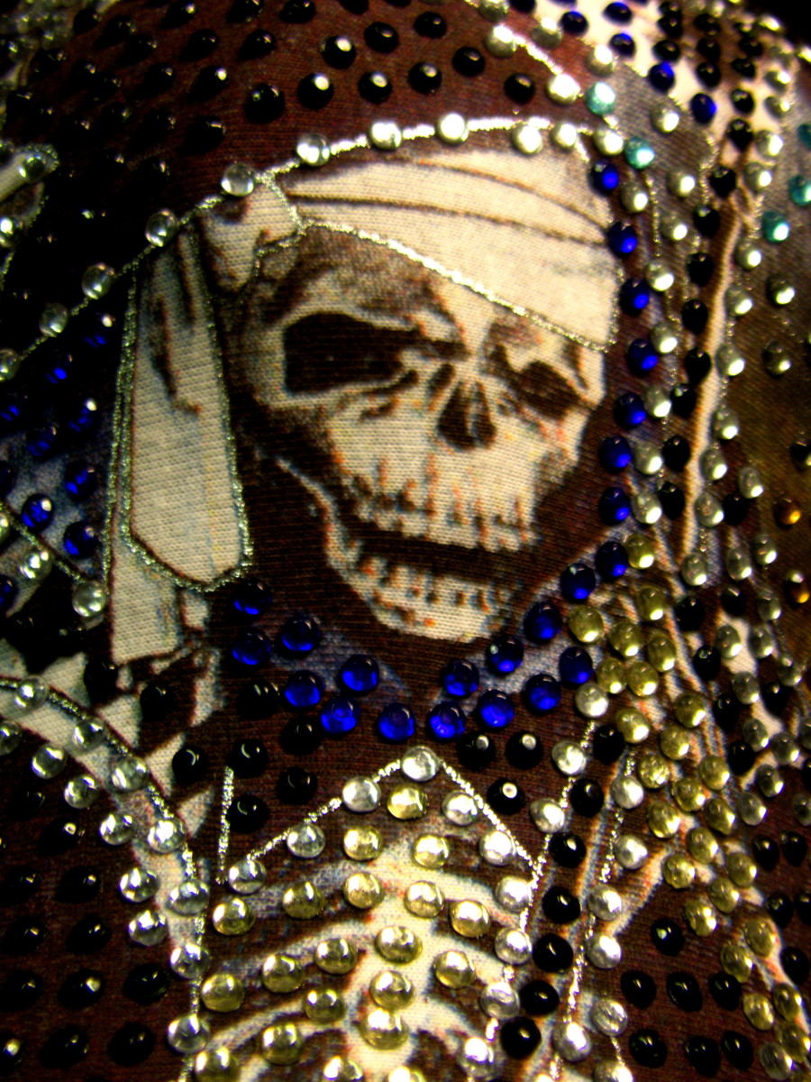 I love my Santa Muerte cap and wear it often. Isn't she pretty? You could certainly bling out a poster or even a print out to honor her.