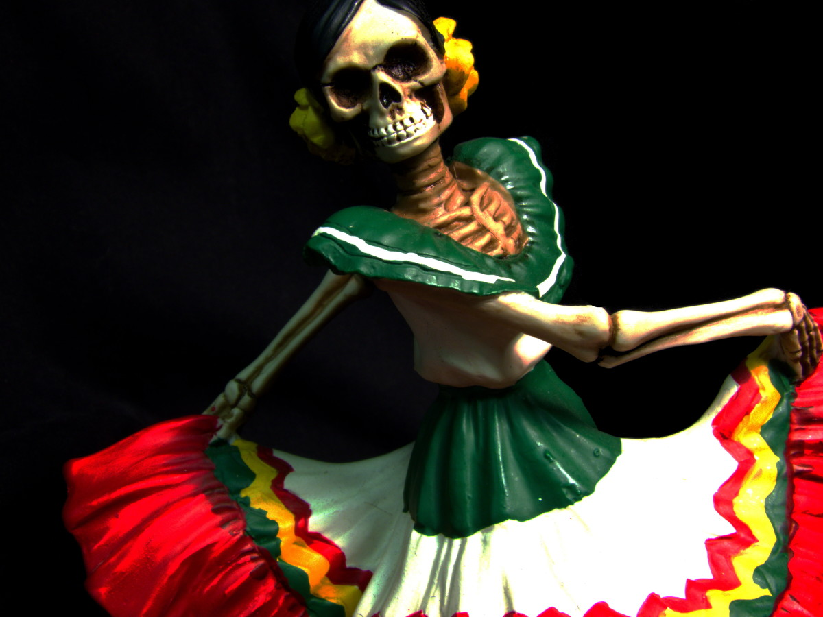 One of the lovely statues I got to honor her roots, this dancer graces her altar year 'round.
