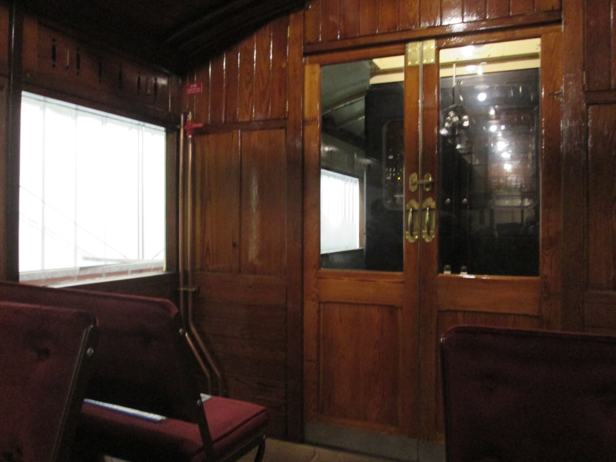 At the other end of the passenger saloon area, the door to the motor compartment and beyond that the second driving compartment