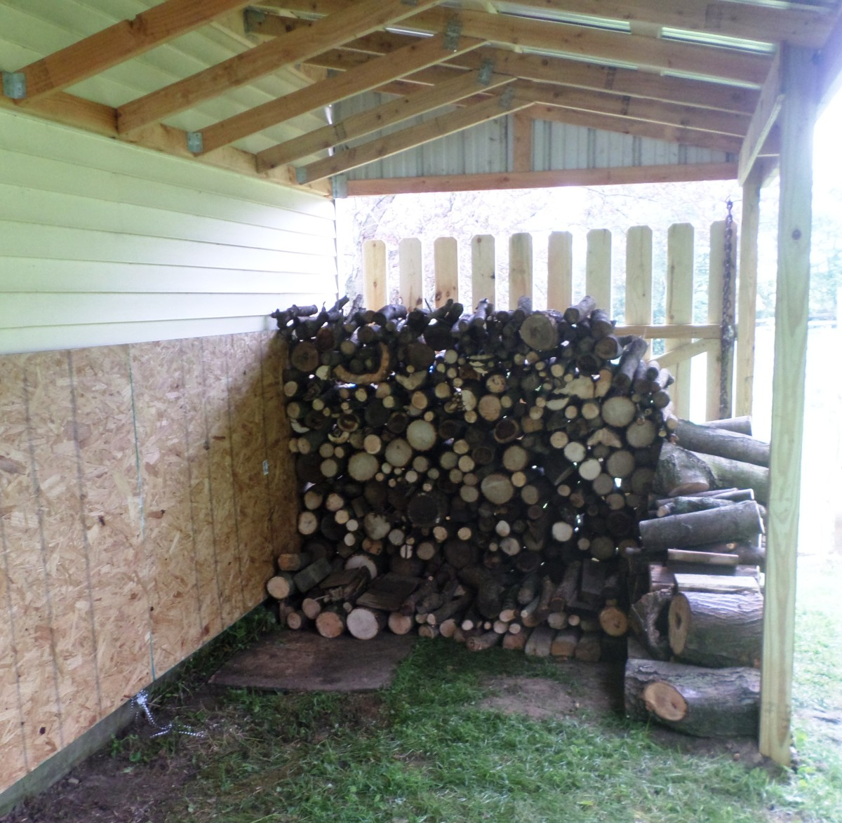 First load of firewood under the shed. Only about 19 more to go.