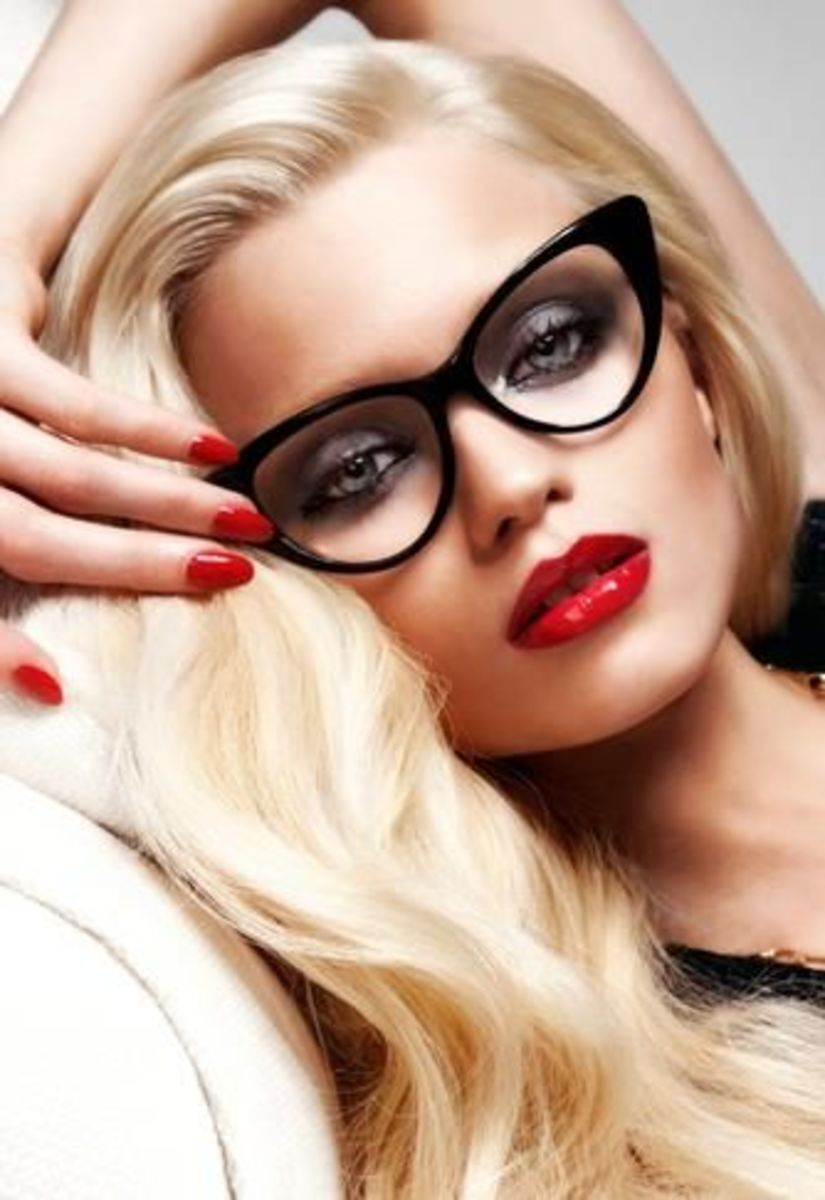 Photo of woman wearing Bold cat's eye frame with red lipstick
