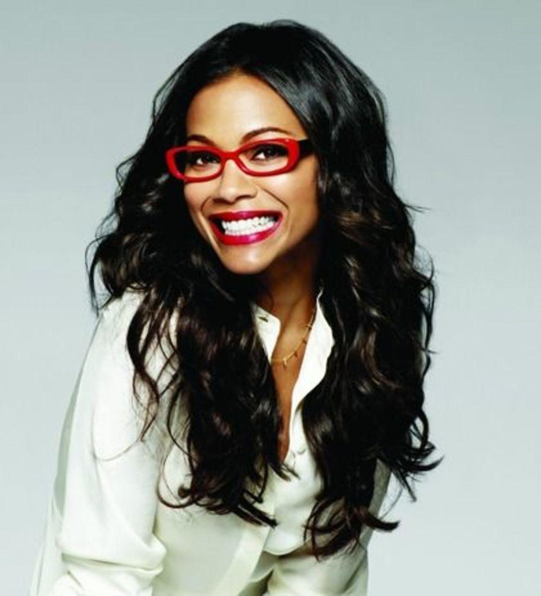 Dark skinned woman wearing bold red framed glasses