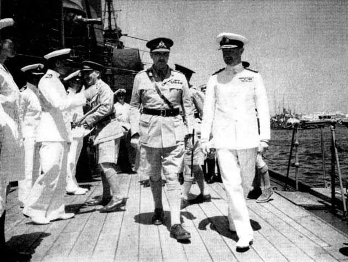Admiral Cunningham (right) and Major General Freyberg walk the deck aboard HMS 'Phoebe' off Crete