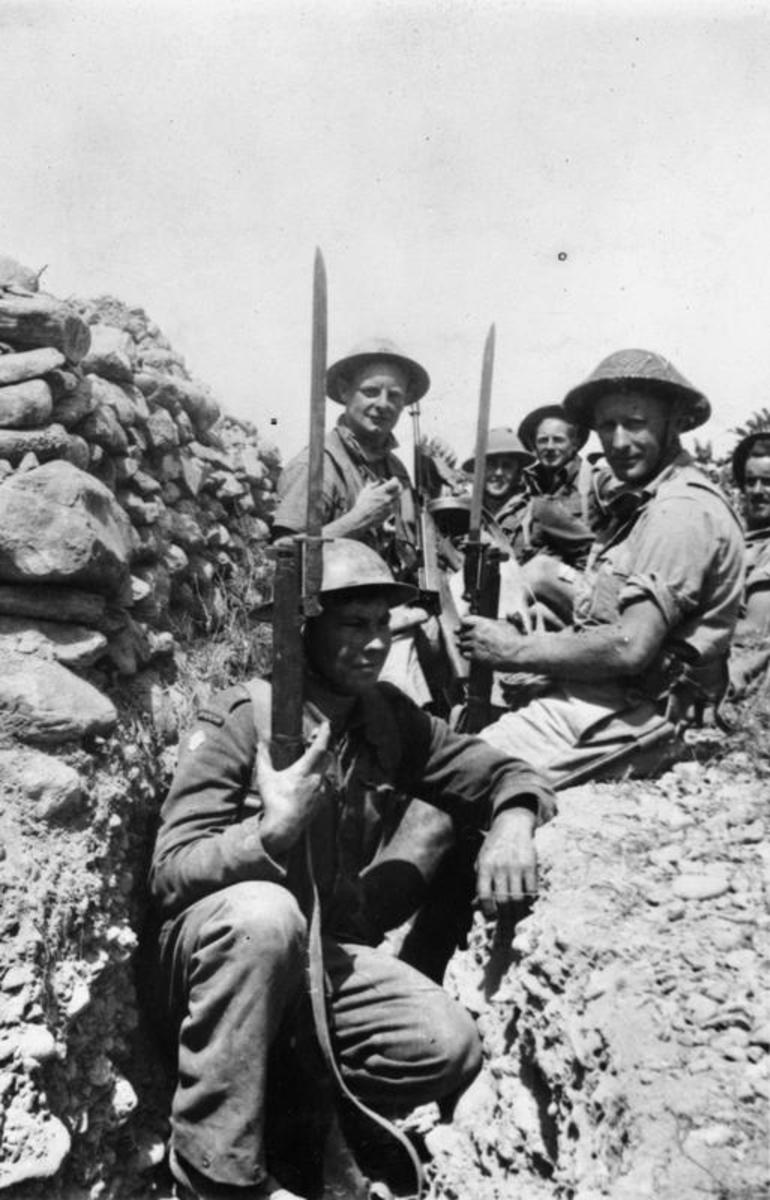 Anzac troops pause guarding a slit trench on Crete during late May