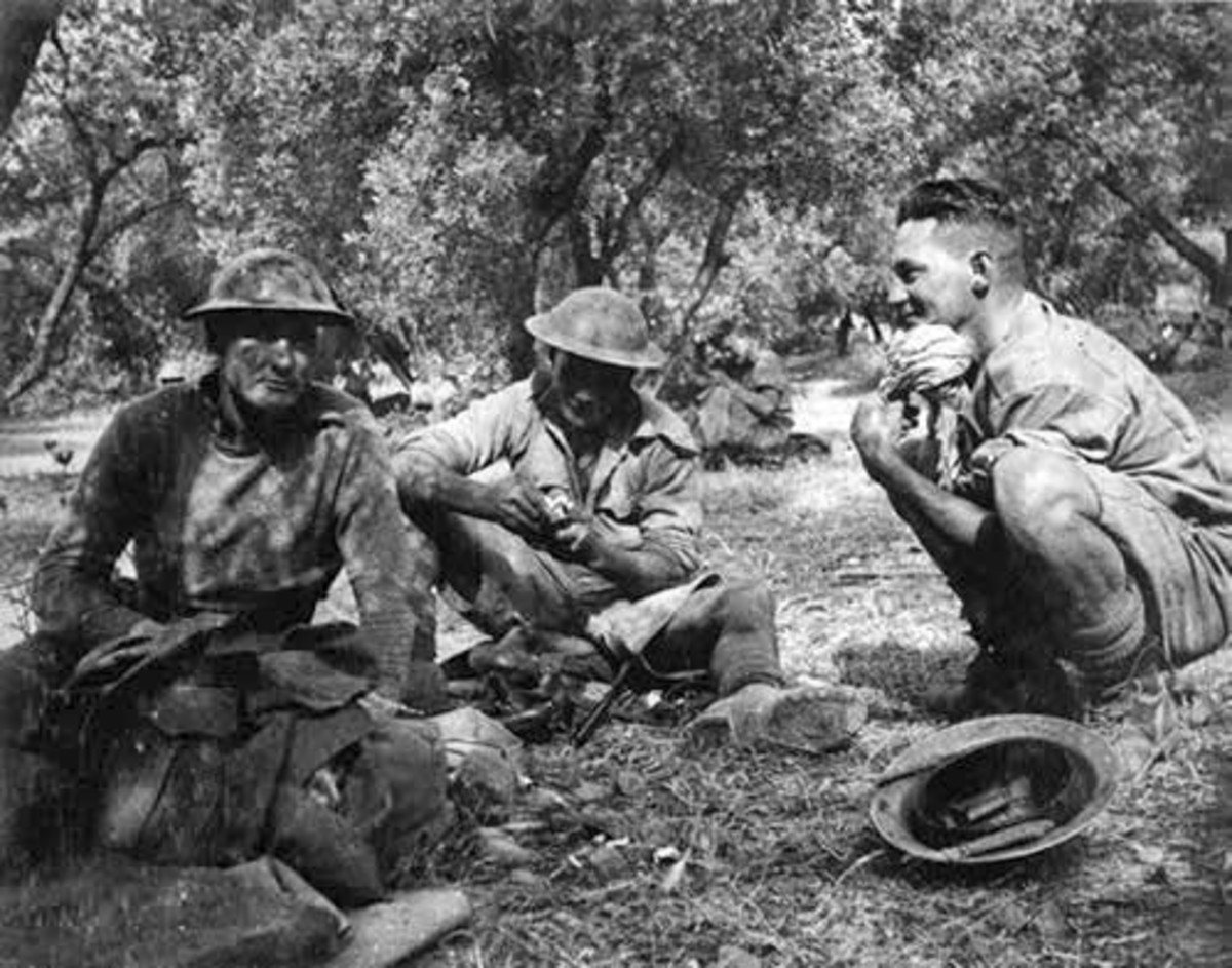 New Zealand troops rest in the shade of an olive grove