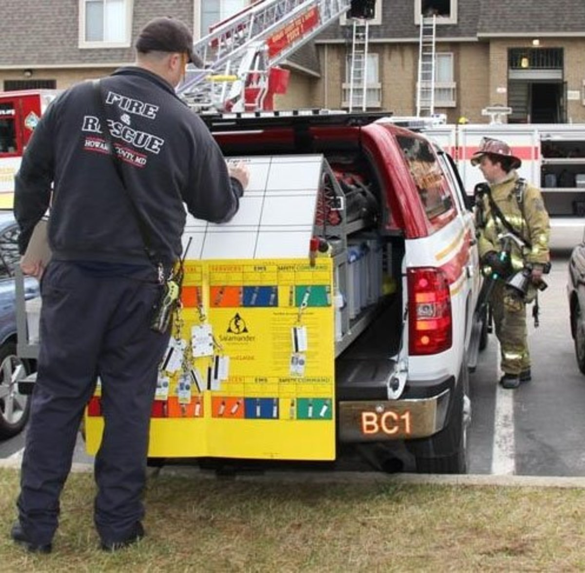 Firefighter using the accountability system to track fireground operations.