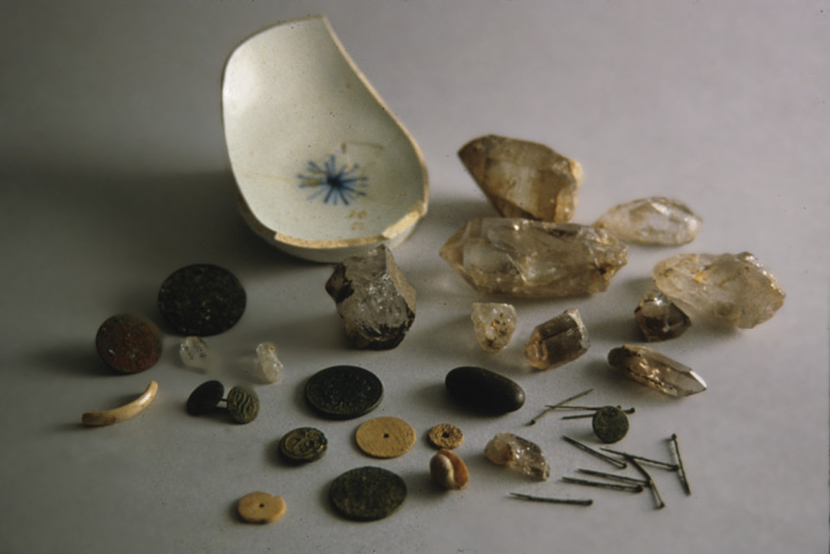 Pierced coins, buttons, straight pins, shells etc.          Hoodoo items belonging to the slaves of Charles Carroll, signer of the Declaration of Independence.