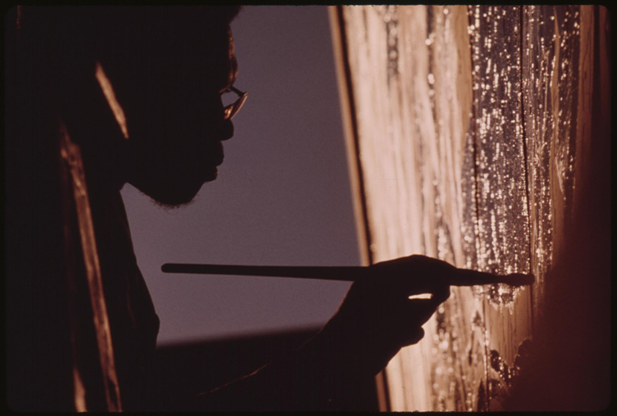 Ron Blackburn painting a mural.