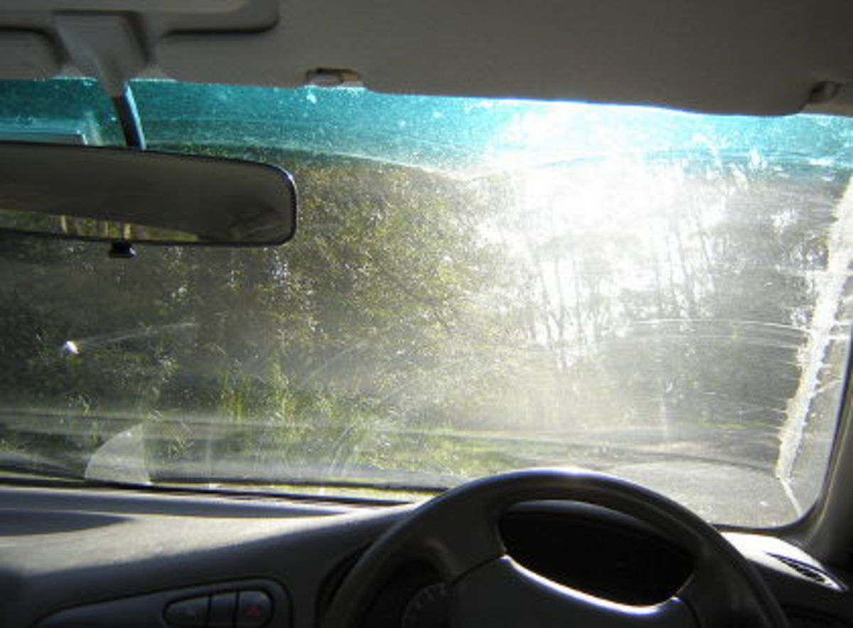 This is a clear sign of worn out wiper blades and a dirty windshield that needs cleaning.