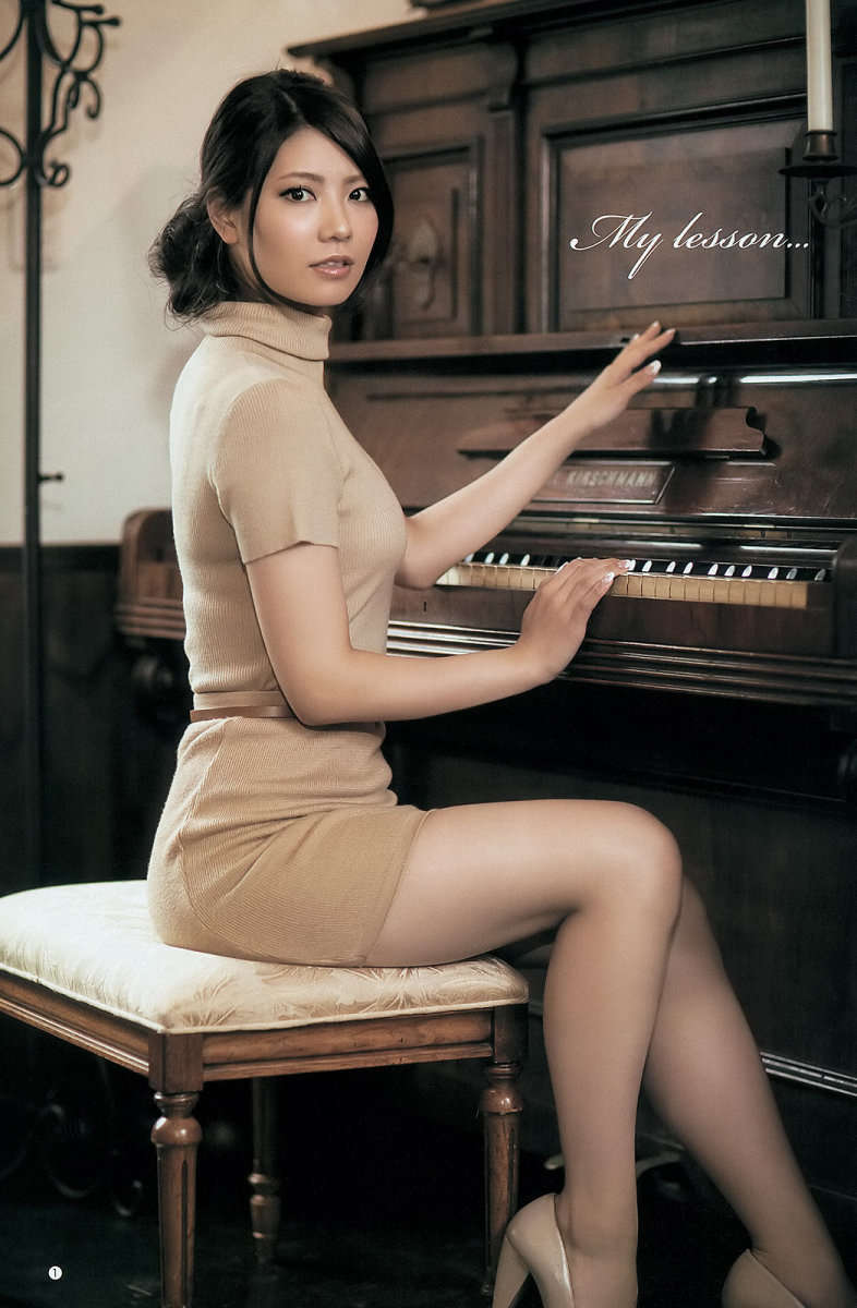 Former AKB48 member Asuka Kuramochi is sitting on a chair next to a piano. The theme of this photo is called My Lesson. Is she ready to play a song? It looks like she is just posing for a picture.