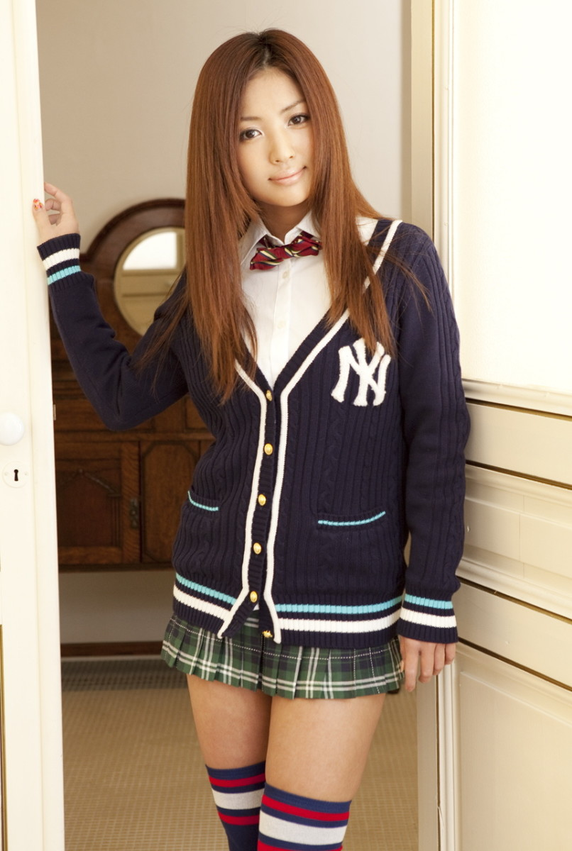 Kana Tsugihara is seen here dressed in a special uniform with the New York Yankees logo on the right side of that uniform.