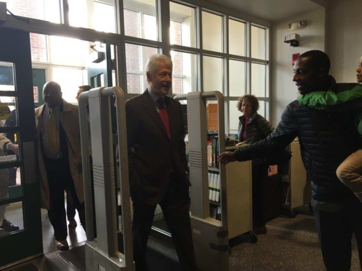 Photo of Clinton in polling station in Newton, MA during voting hours.