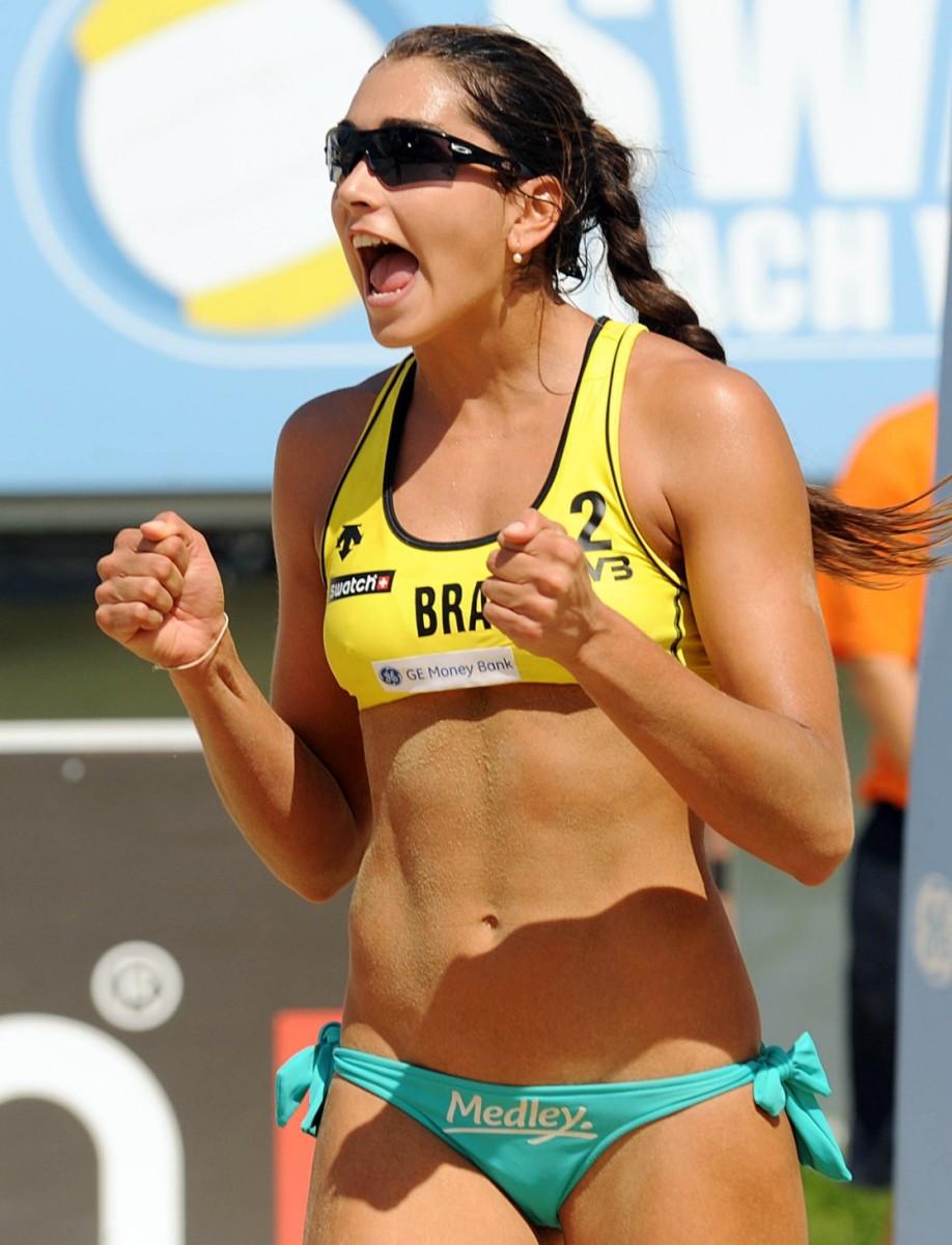 Carolina Salgado celebrates winning a point during a match.