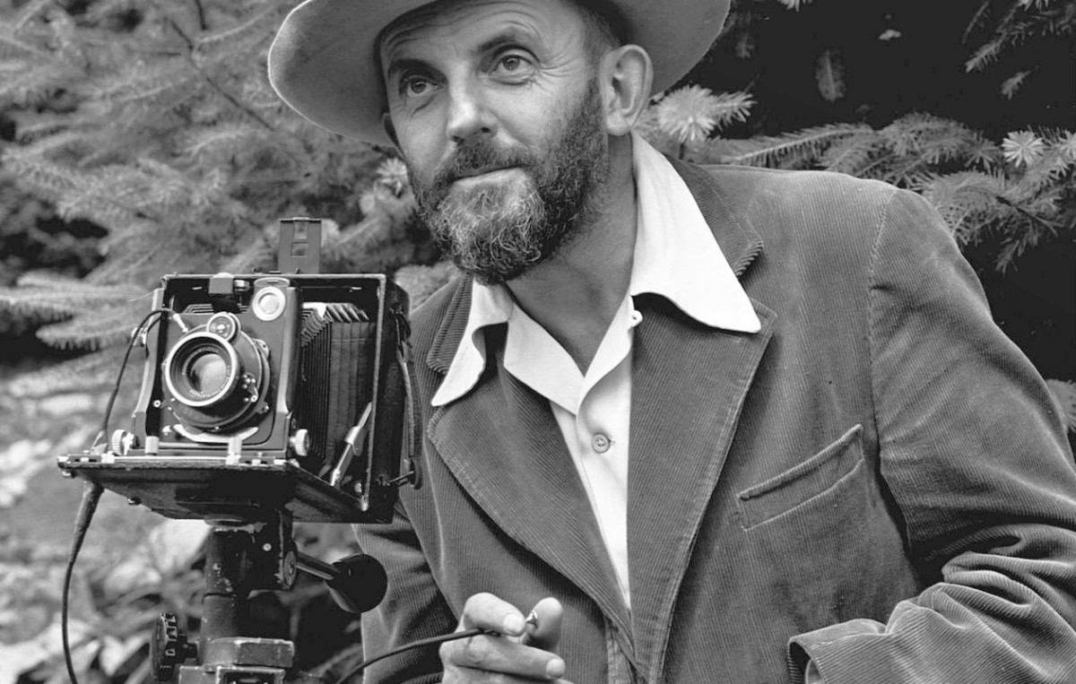 A young Ansel Adams pictured with his trusty camera and trademark beard.
