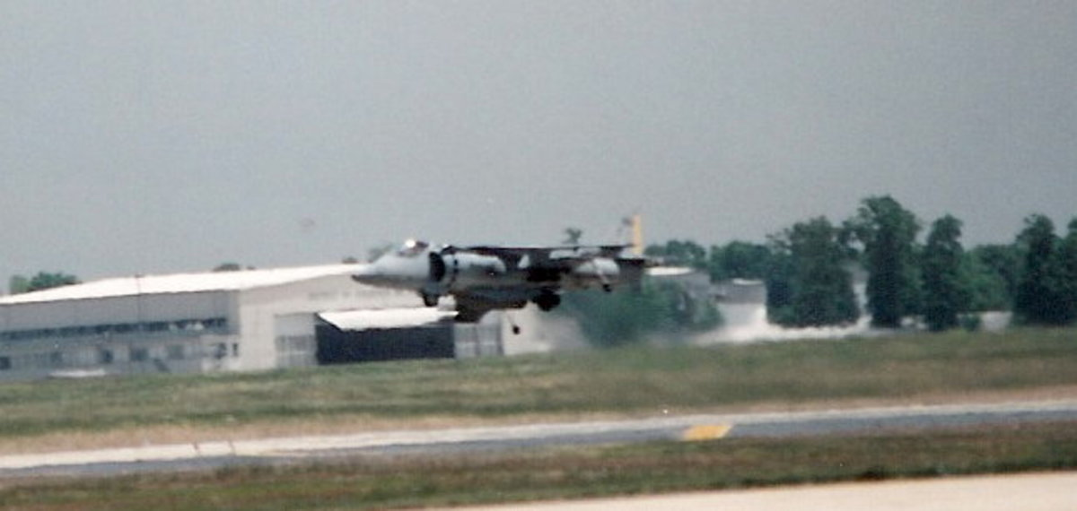 A USMC AV-8B hovers at an Andrews AFB, Joint Service Open House.