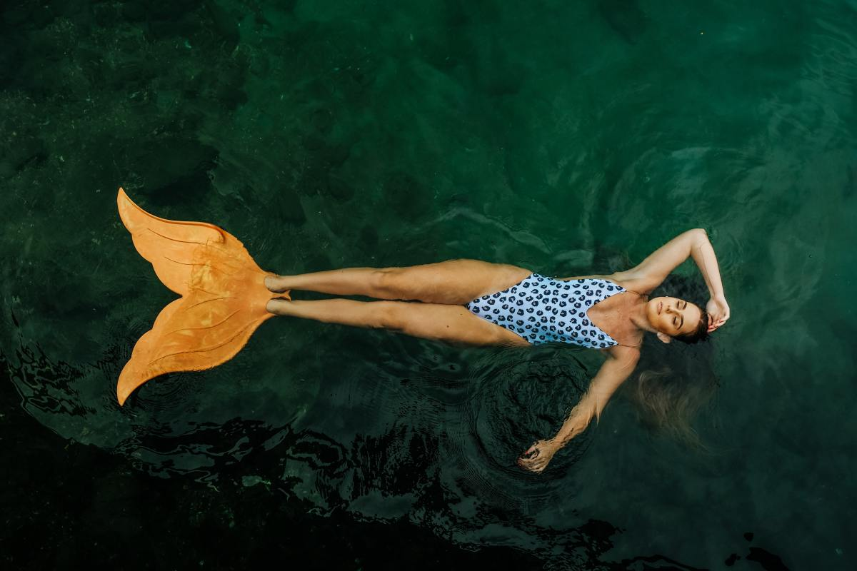 A mermaid rehearsing her monofin tail insert.