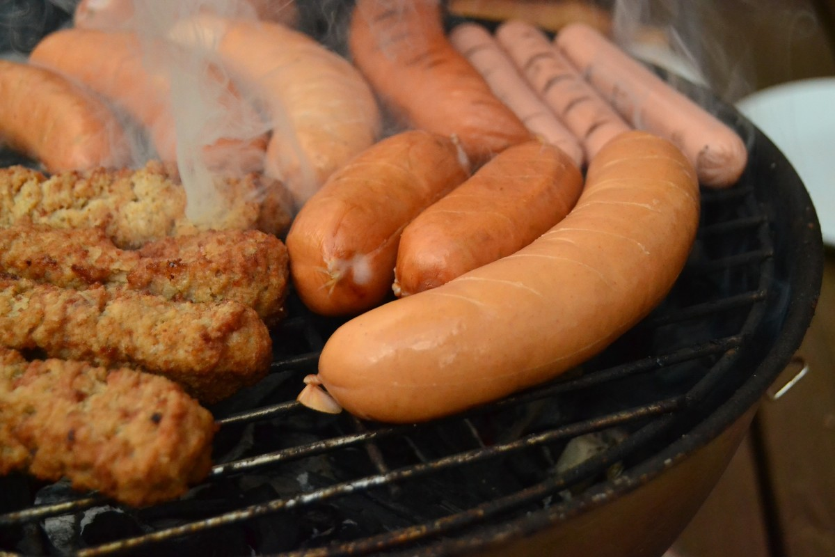 sausages being barbecued