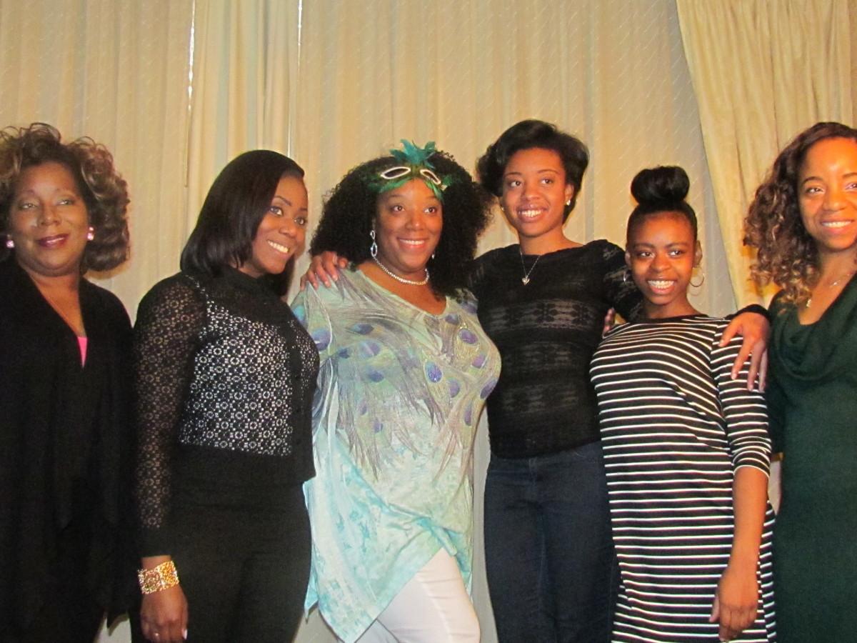 Chante, poses with her cousins, KaShia, Lynetta, Taylor, Kasha, Wanisha and Jaleesa.