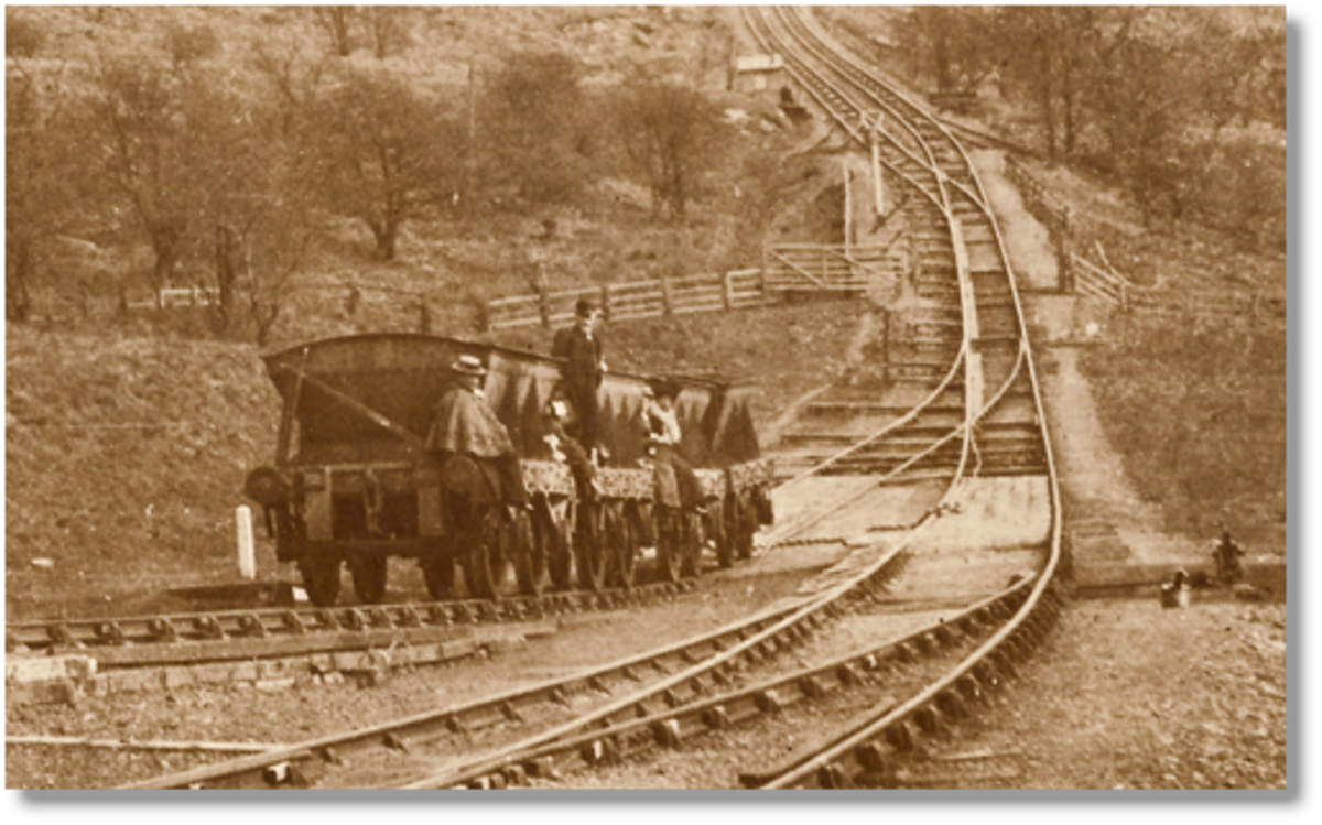Near Incline Bottom, a rake of 8 ton steel mineral wagons carries 'passengers' up the incline past the weigh hut