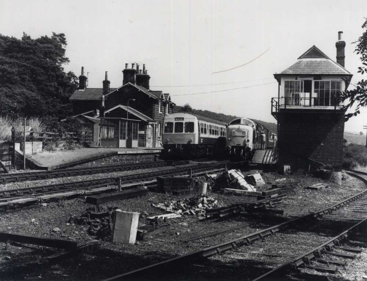 Castleton Station in the 1960s. A Whitby-bound dmu stands at the 'Down' platform, a  visiting Deltic diesel at the 'Up' - is this the year Whitby Town FC qualified to play in the FA Cup Final at Wembley?