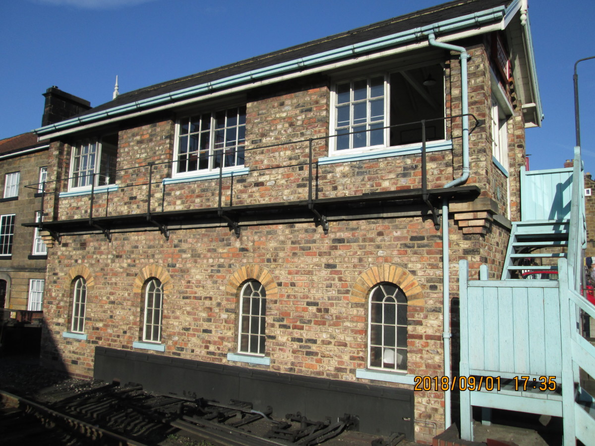 Seen from the front, the signal cabin walkway at window level to keep the glass clean (essential for safety's sake) and stairway painted light blue in the manner of British Railways' North Eastern Region