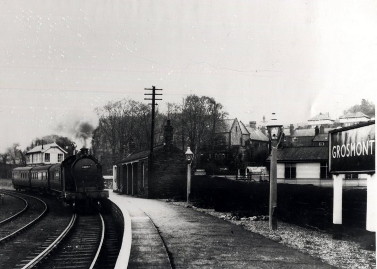 A Class A8 4-6-2 tank engine enters from Whitby. The platform shelter is still there, built by the NER in the mid-1860s. Trains to and from York came through the far platforms. Plinth-based signal cabin behind the engine was demolished mid-1980s