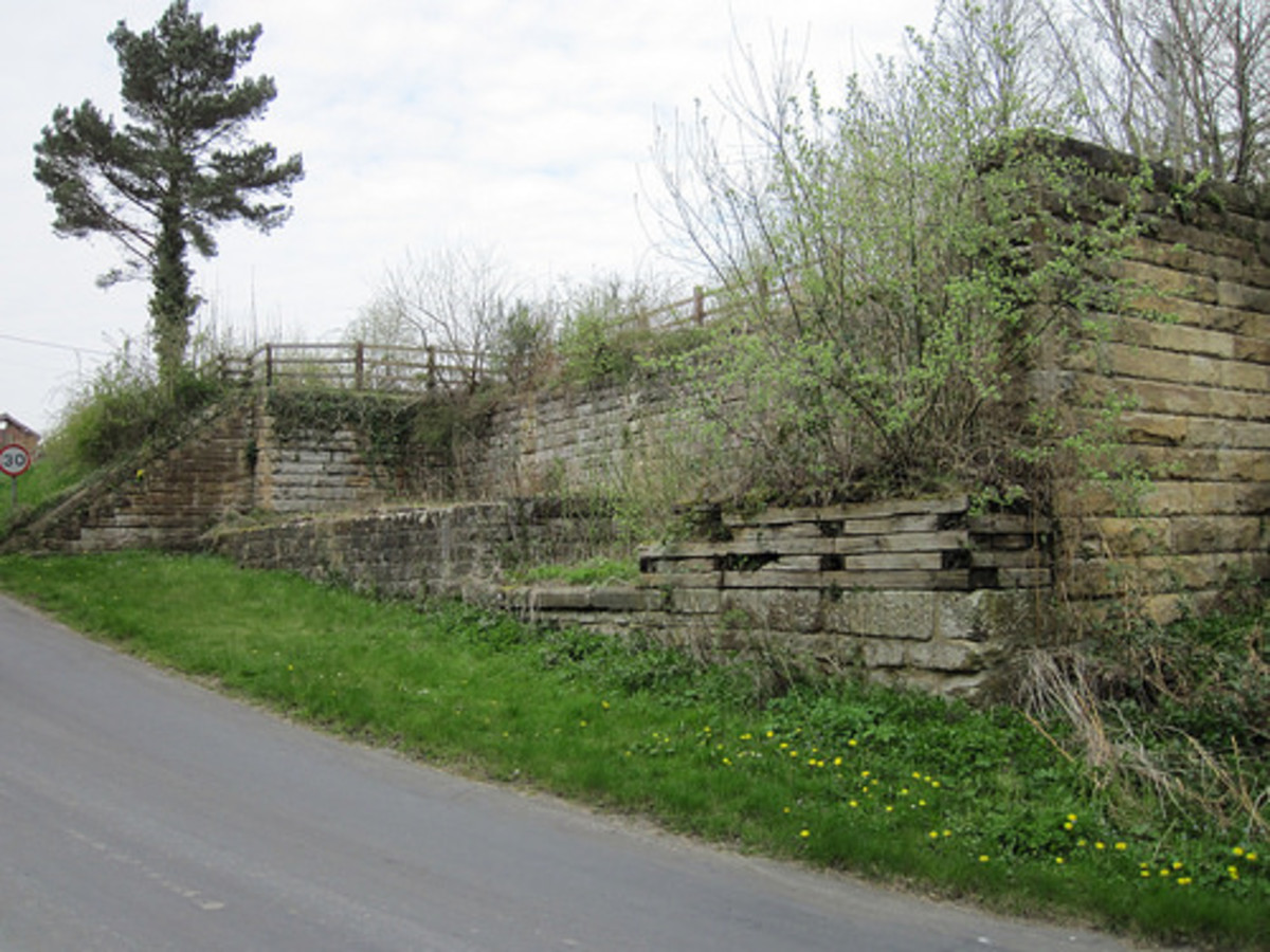 Beside the sloping road down to the River Esk the coal cells have lost their dividing walls. Horse-drawn carts would originally have stood here for loading, latterly motor lorries until 1965.