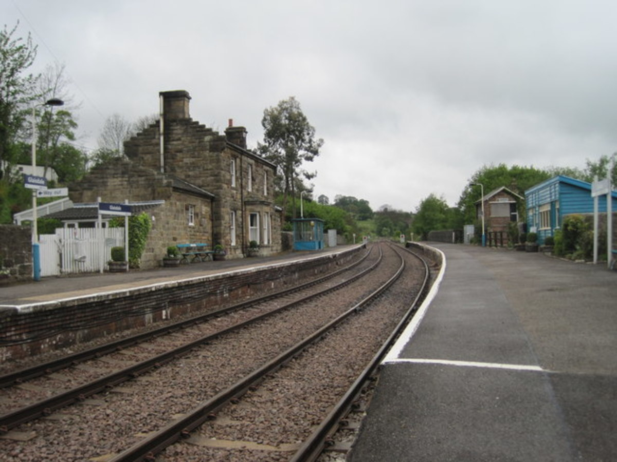 Glaisdale Station looking west, with the Station Master's house, offices and facilities on the 'Up' platform. A waiting shelter in the earlier NER building style stands midway on the 'Down' platform near the former signal cabin
