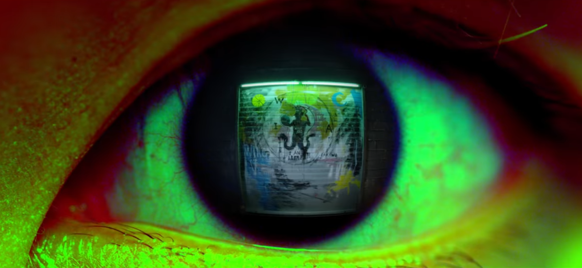 The graffiti of Abraxas in J-Hope's eye at 1:06.