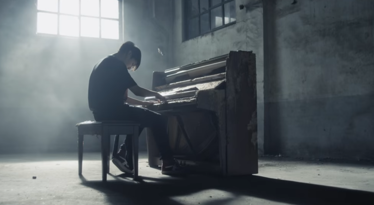 Jungkook playing the piano.
