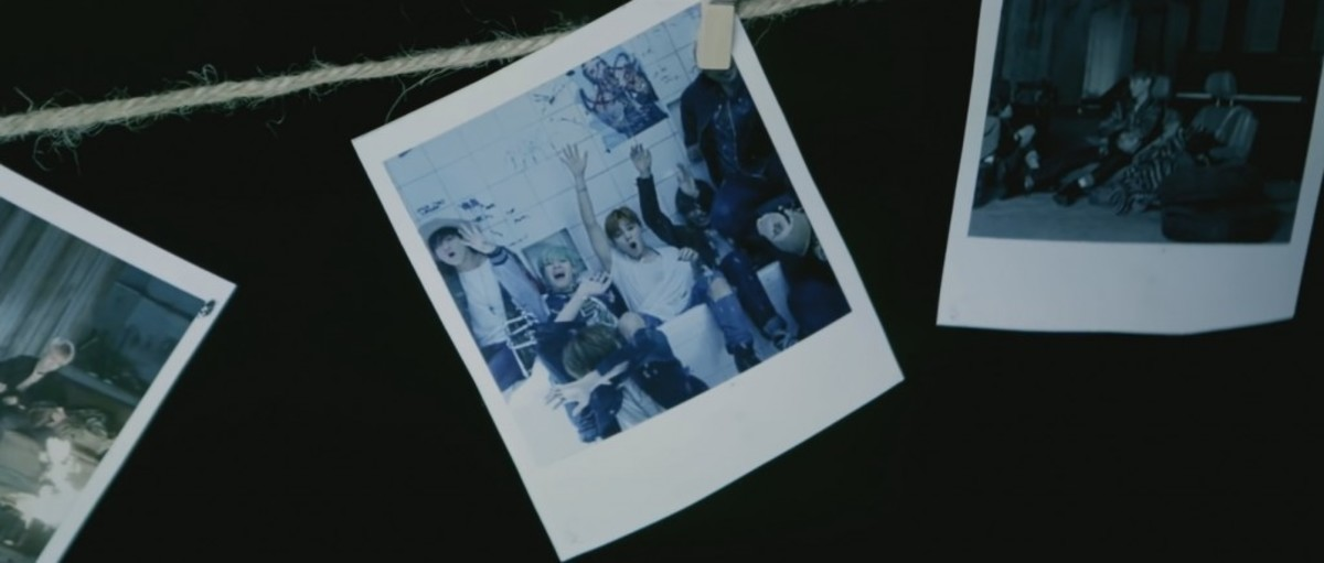 """The photo of them together in """"Young Forever"""" at 2:52."""