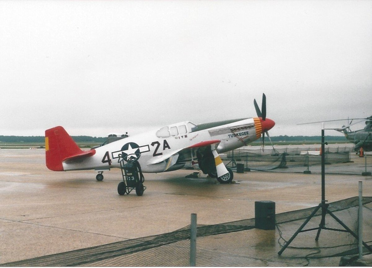 "A P-51 Mustang in the markings of the Tuskegee airmen, the ""Red Tails"". Joint Base Andrews, May 2012."