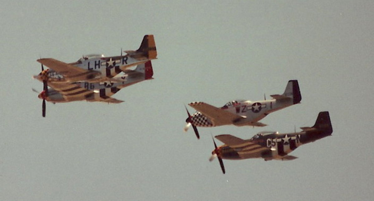 A flight of P-51s at an Andrews AFB open house.