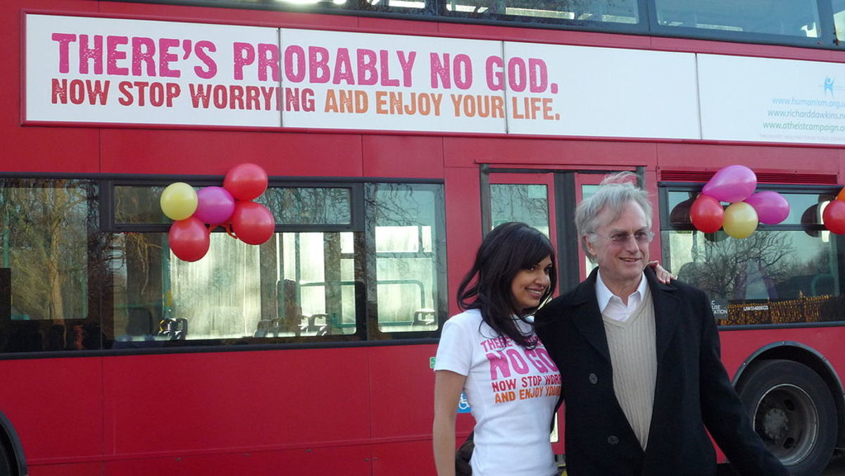 "The biologist Richard Dawkins with comedian, and journalist, Ariane Sherine at the launch of the Atheist Bus Campaign.  The campaign began in London, and used the slogan: """"There's probably no god. Now stop worrying and enjoy your life."""