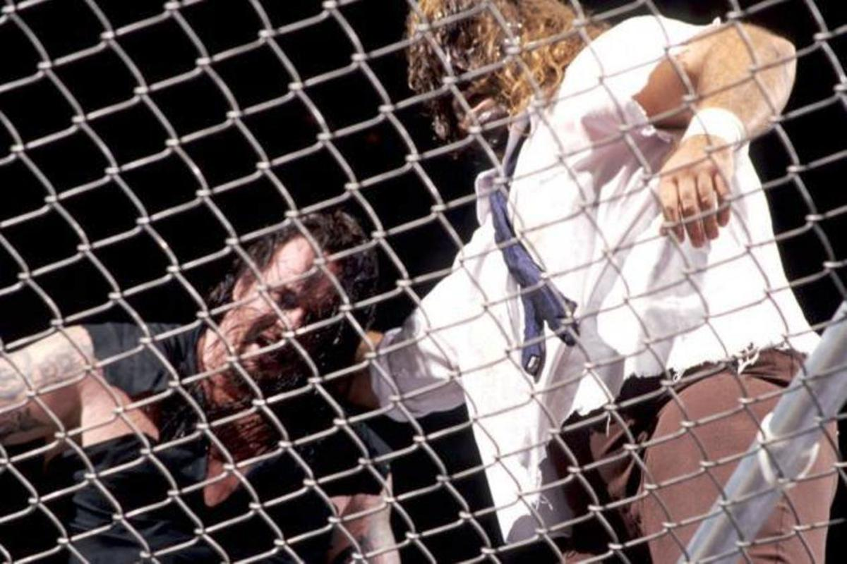 The Undertaker and Mankind on top of a hell in a cell.
