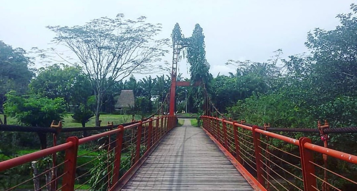 A red bridge looks strikingly impressive in such verdant landscape