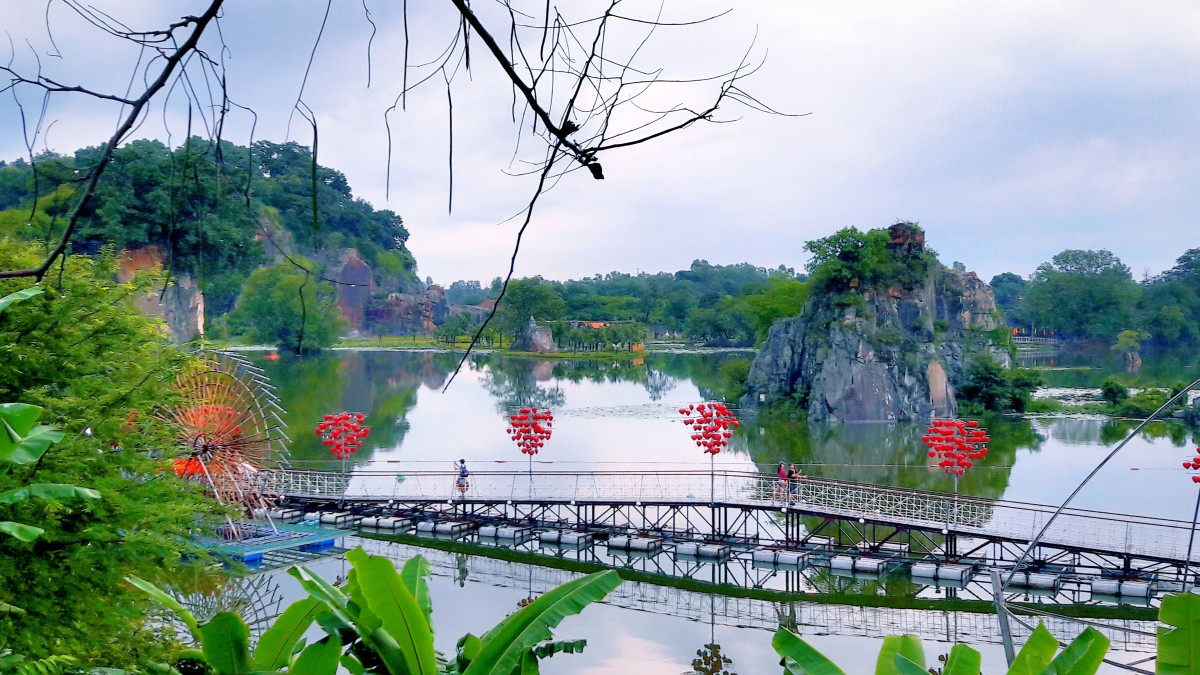 The Bridge of Love mirrors on the lake, which is a beautiful scene for couples in love to enjoy