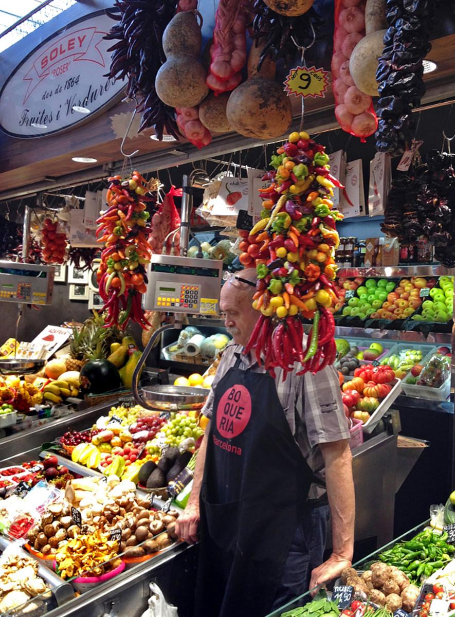 Fruit and vegetable vendor at La Boqueria market.