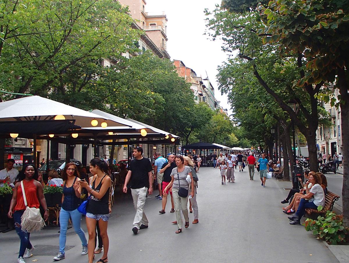Pedestrian promenade in Eixample neighborhood.