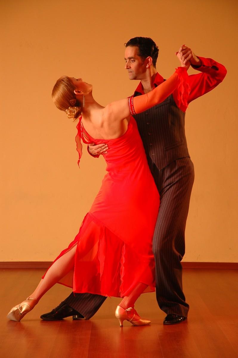 A couple doing ballroom dancing.