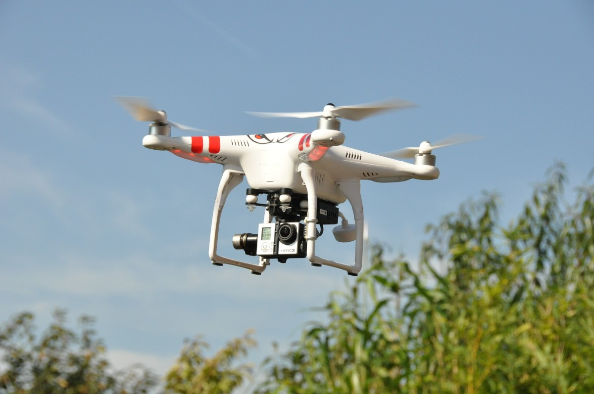A drone with camera (in flight) to take photos.